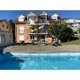 Das Schneckenhaus - Ferienwohnung mit Pool und Seeblick